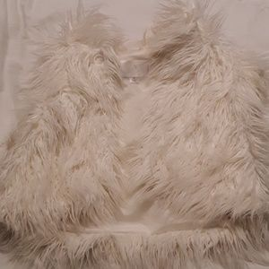 Furry. Off white ,cropped , cap sleeve vest.